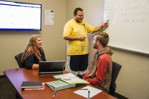 Students in a Group Study Room in the Mathewson-IGT Knowledge Center